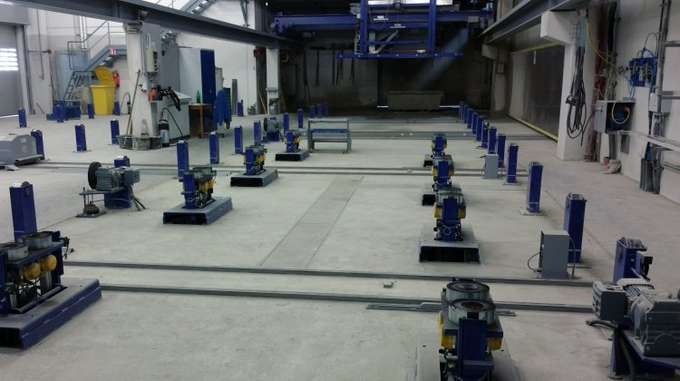 Central transport system in a precast production plant